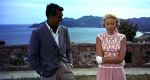 To-Catch-a-Thief_Grace-Kelly-Cary-Grant-coral-top-skirt_front-pleats